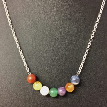 A necklace with 925 sterling silver chain and 8mm gemstone beads in the order of the colours of the rainbow song