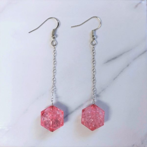 Hook earrings with chain which holds pink crackle effect beads